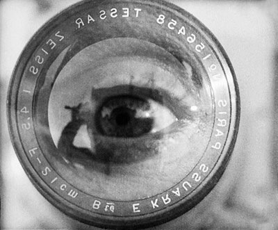 an essay on the film man with the movie camera Just watch dziga vertov's amazing experimental film and appreciate the creative energies that october 1917 unleashed a clear (and superior) forerunner of films like koyaanisqatsi, the man with the movie camera will tease and provoke your eyes until it's quick cut ending will leave you gasping for more.
